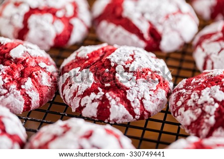 Red velvet crinkle cookies cooling on a baking rack for Christmas holiday baking - stock photo