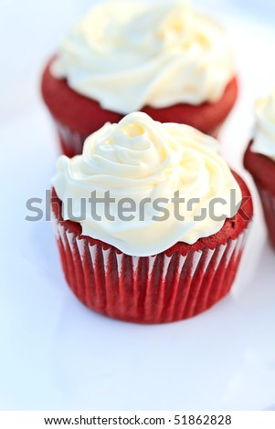 Red Velvet Cupcake with buttercream icing. Shallow DOF. - stock photo