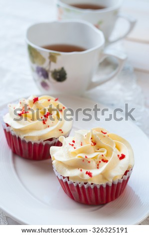 Red velvet cupcake with tea