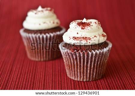 Red velvet cupcakes on red background - stock photo