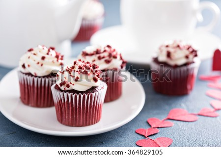 Red velvet cupcakes with decorations for Valentines day - stock photo