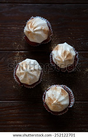 Red velvet cupcakes with white buttercream - stock photo