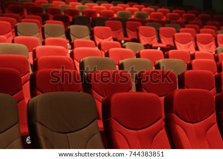 Red Velvet Fabric Cloth Empty Many Seats Row Column in Movie Theater Concert or Seminar Conference room