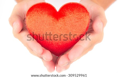 red velvet heart in hand on white background