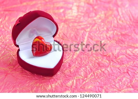 Red velvet Heart-shaped Gift Box with heart on a background a wrapping paper - stock photo