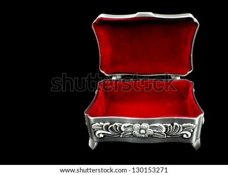 Red velvet inner side of jewelry box on black background - stock photo