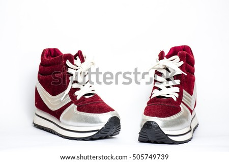 Red velvet sneakers on white