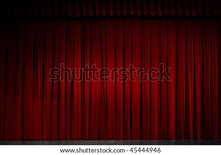 Red velvet theater curtain. - stock photo