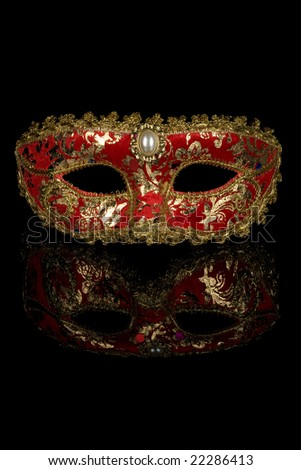 Red venetian carnival mask isolated on black background - stock photo