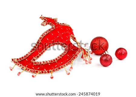 Red Venice mask with Christmas globes on white - stock photo