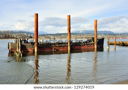 Red vessel fastened to metal poles