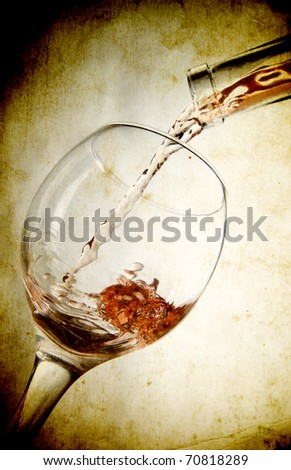 Red vine in glass on vintage background - stock photo