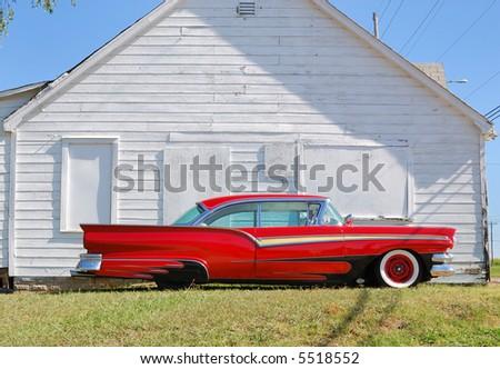 Red 1950 Vintage Automobile - stock photo