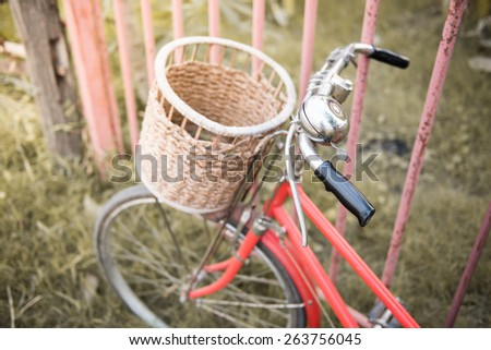 red vintage bicycle with selective focus effect ; vintage filtered style - stock photo