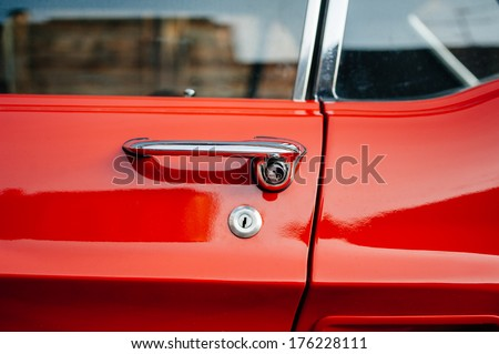 Red vintage car handle detail extreme detailed close-up - stock photo