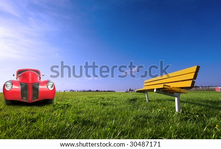 Red Vintage Car In The Park - stock photo