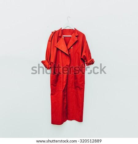 Red Vintage Coat on hanger. - stock photo