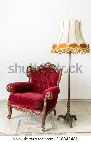 Red Vintage retro style Chair with lamp - stock photo