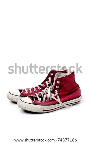 red vintage shoes on white background, copyspace