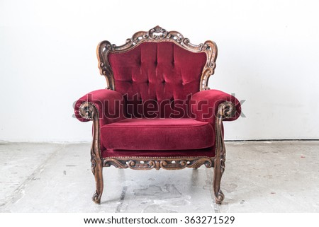 Red vintage sofa on white wall.