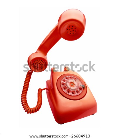 Red vintage telephone with the handset  on first plane - stock photo
