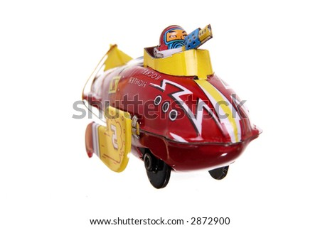 red, vintage tin airplane toy isolated on white ground