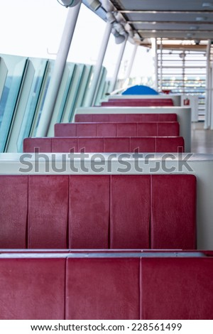 Red vinyl booths in an outdoor patio at a restaurant - stock photo