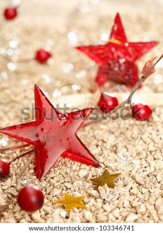 Red vitreous Christmas stars and two golden on a festive christmas background