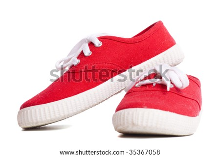 Red vivid new Sneakers isolated on white - stock photo