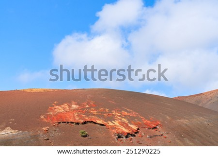 Red volcanic mountain landscape in Timanfaya National Park, Lanzarote, Canary Islands, Spain - stock photo