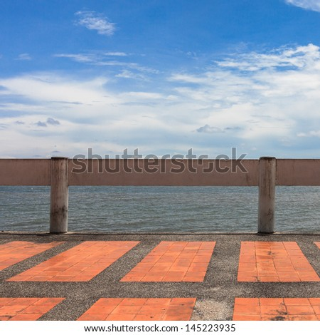 red walkway along the coast line of sea of gulf of thailand - stock photo