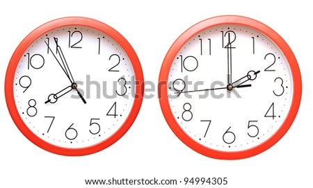 red wall clocks on white - stock photo
