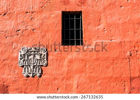 Red wall of Santa Catalina Monastery in the UNESCO World Heritage center of Arequipa, Peru - stock photo