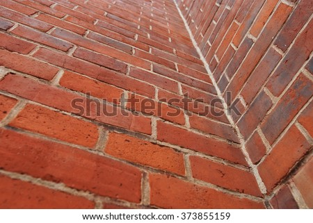red wall of The Red Church,  brick texture, orange background, corner wall - stock photo