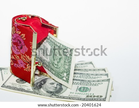 Red wallet and dollars - stock photo