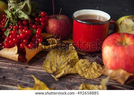 Red warm tea cup with berries