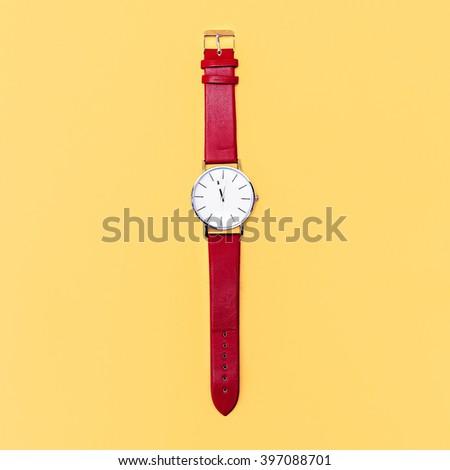Red Watch on yellow background. Minimalism design - stock photo