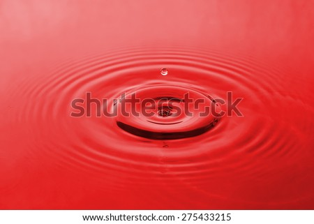 red water and water drop for background - stock photo