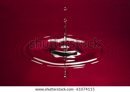 Red water environmental abstract background - red water drop splashing in water. - stock photo