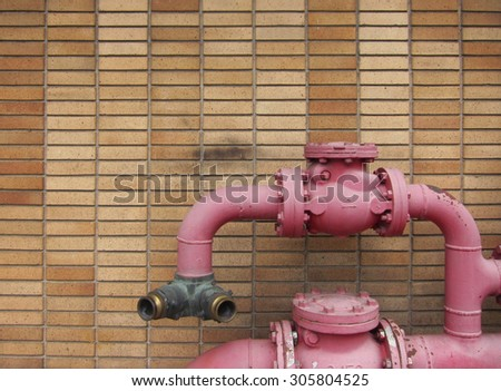red water pump - stock photo