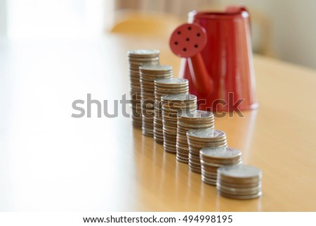 Red watering can with coin (path in side) isolate