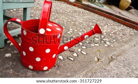 Red Watering Pot