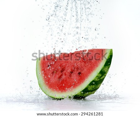 Red watermelon with splash of water - stock photo