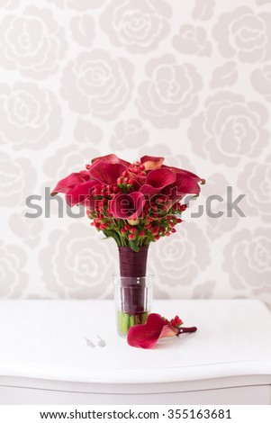 Red wedding bouquet and boutonniere from callas
