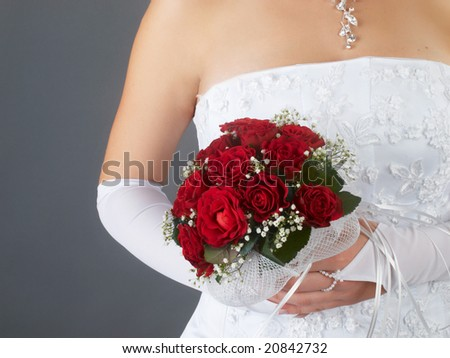 red wedding bouquet at bride's hands