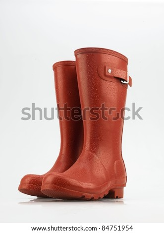 Red Wellies with drops - stock photo