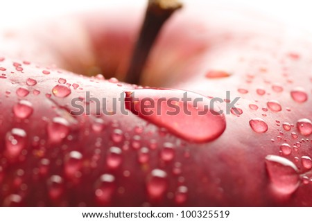 red wet apple with big droplet, macro shot - stock photo