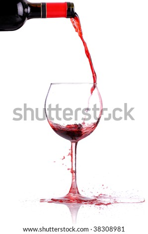 red whine pouring in a glass