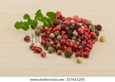 Red, white and black pepper mix heap - stock photo