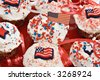 Red, White and Blue American holiday celebration cupcakes. - stock photo
